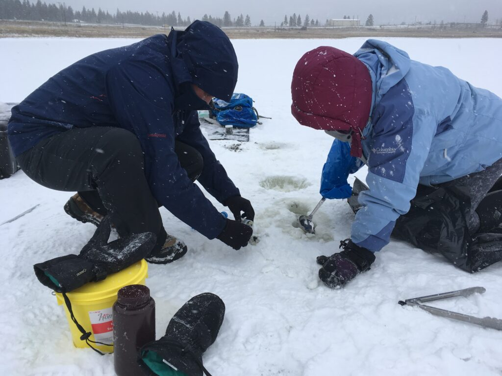 Alex Pontefract and Hannah Dion-Kirschner (Northwestern University) extracting sediment and salt samples through a borehole at Salt Lake. The brine temperatures can be as cold as -4C.